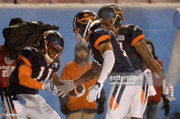 Donteea Dye Jr. #11 of Orlando Apollos celebrates a touchdown against the Salt Lake Stallions with Rannell Hall and Jalin Marshall during their...