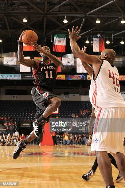 Dontell Jefferson of the Utah Flash goes to the basket over Alton Ford of the Rio Grande Valley Vipers during the NBA DLeague game on November 29...