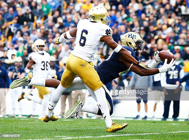 Dontez Ford of the Pittsburgh Panthers catches a pass in front of KeiVarae Russell of the Notre Dame Fighting Irish in the second quarter before a...