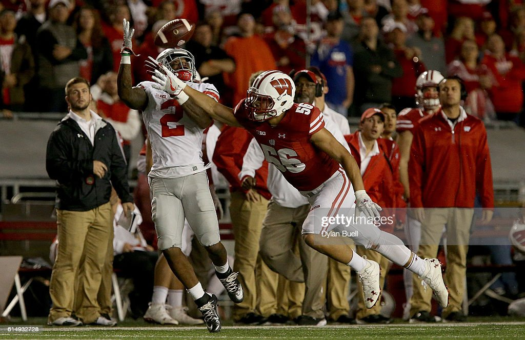 Dontre Wilson #2 of the Ohio State Buckeyes makes a catch past Zack Baun #56 of the Wisconsin Badgers in overtime at Camp Randall Stadium on October 15, 2016 in Madison, Wisconsin.