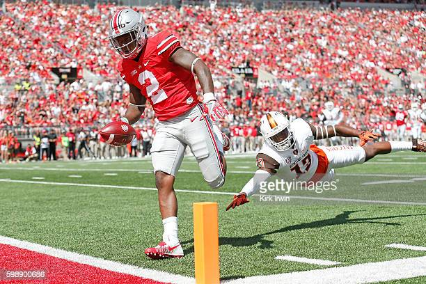 Dontre Wilson of the Ohio State Buckeyes out runs Jamari Bozeman of the Bowling Green Falcons to score a touchdown during the first quarter on...