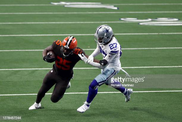 Dontrell Hilliard of the Cleveland Browns runs the ball against Trevon Diggs of the Dallas Cowboys in the second quarter at AT&T Stadium on October...