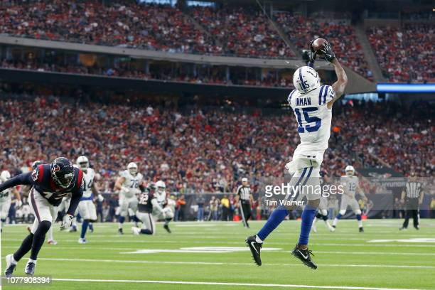 Dontrelle Inman of the Indianapolis Colts catches a pass for a touchdown defended by Shareece Wright of the Houston Texans in the second quarter...