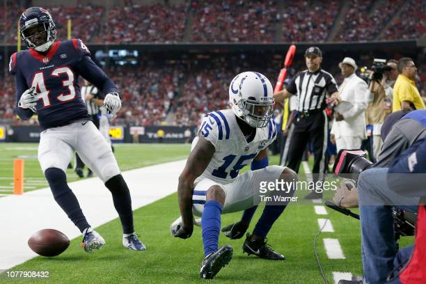 Dontrelle Inman of the Indianapolis Colts celebrates a touchdown reception against Shareece Wright of the Houston Texans in the second quarter during...