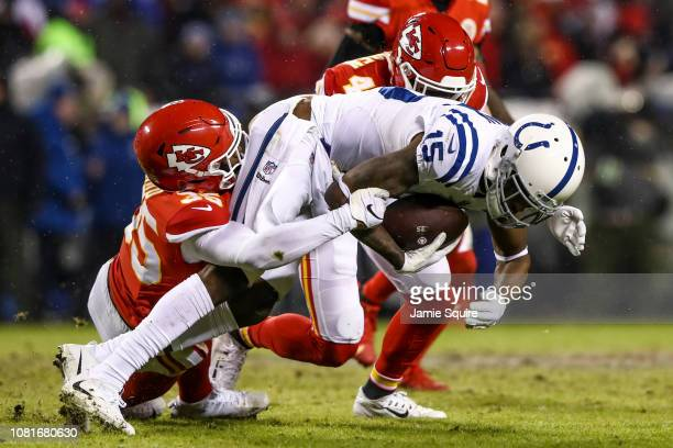 Dontrelle Inman of the Indianapolis Colts is tackled by Charvarius Ward of the Kansas City Chiefs during the third quarter of the AFC Divisional...