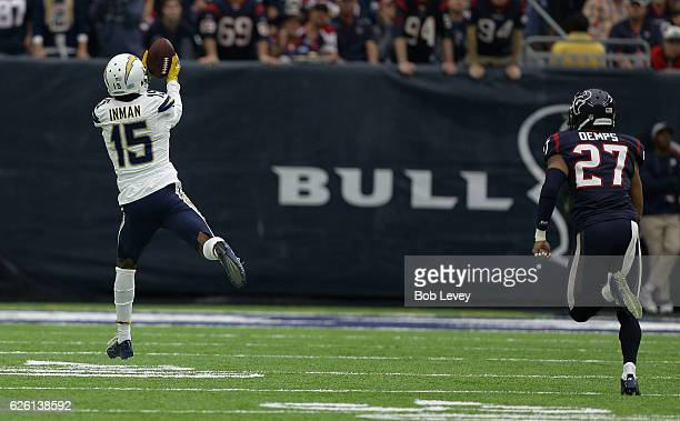 Dontrelle Inman of the San Diego Chargers catches a pass for a 52 yard touchdown as Quintin Demps of the Houston Texans looks on at NRG Stadium on...