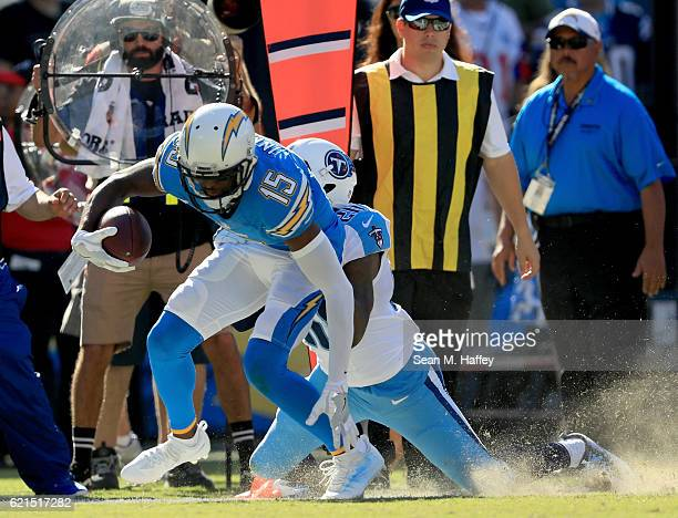 Dontrelle Inman of the San Diego Chargers drags Perrish Cox of the Tennessee Titans to make a first down in the first half at Qualcomm Stadium on...