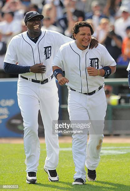 Dontrelle Willis and Miguel Cabrera of the Detroit Tigers celebrate the victory against the Cleveland Indians at Comerica Park on April 11 2010 in...