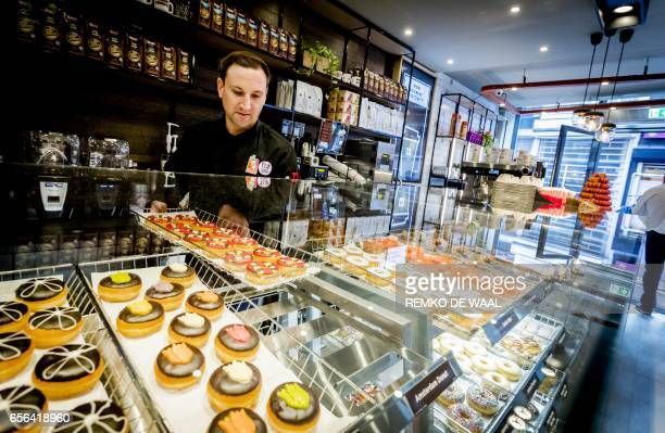 Donut brand Dunkin' Donuts prepares for the opening of the first store in Amsterdam on March 22 2017 The Dunkin' Donuts store will open on March 23rd...