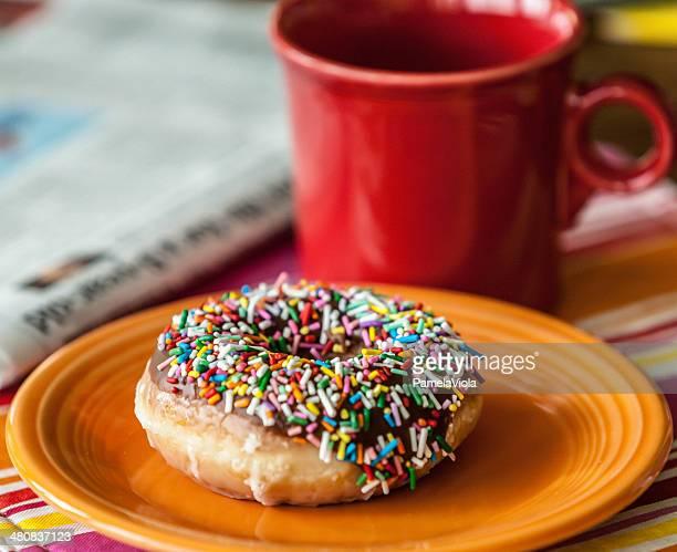 Donut, coffee and newspaper