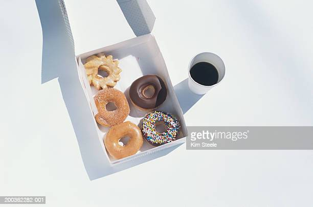 Donuts and coffee to go, overhead view