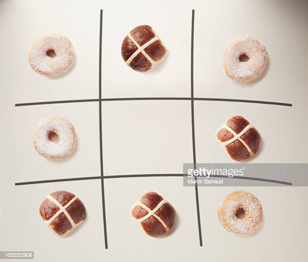 Donuts and hot cross buns on tic-tac-toe grid