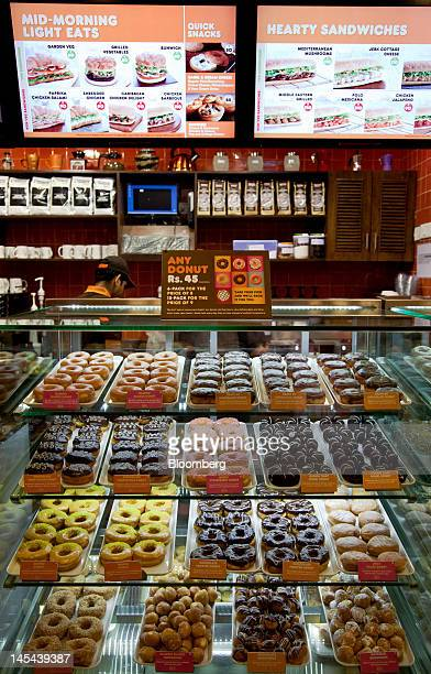 Donuts are displayed at the new Dunkin' Donuts store in DLF Place in New Delhi India on Wednesday May 30 2012 Most of the 350450 new stores Dunkin'...