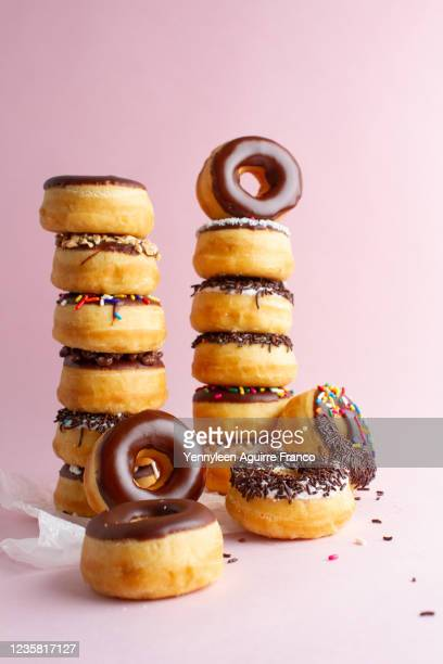 16 donuts of chocolate on stock - stack stock pictures, royalty-free photos & images