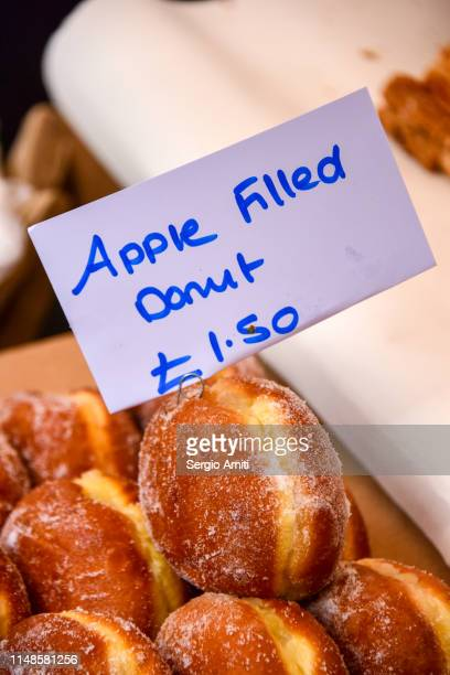 donuts on a street market stall - price tag stock pictures, royalty-free photos & images