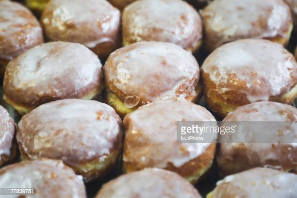 Donuts with icing for Fat Thursday Fat Thursday is a traditional Catholic Christian feast on the last Thursday before Lent It symbolizes the...