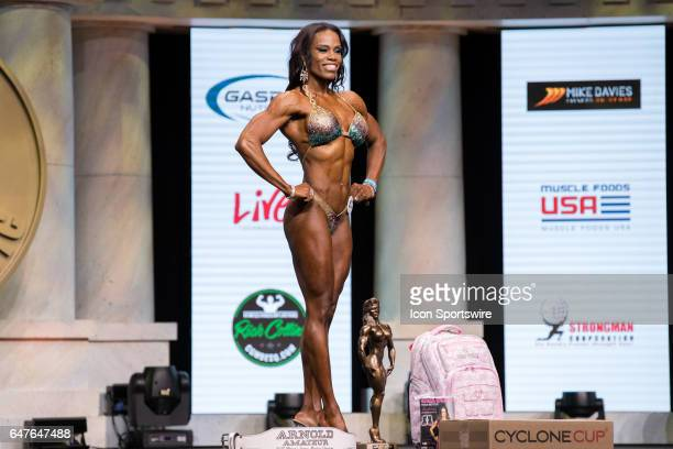 Donya Jackson poses for photographers after winning the Amateur Figure Overall Champion at the Arnold Amateur IFBB / NPC International Bodybuilding...