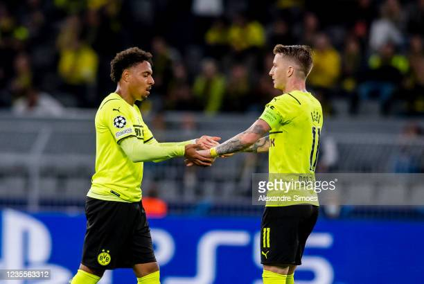 Donyell Malen and Marco Reus of Borussia Dortmund in action during the Champions League Group C match between Borussia Dortmund and Sporting Lissabon...