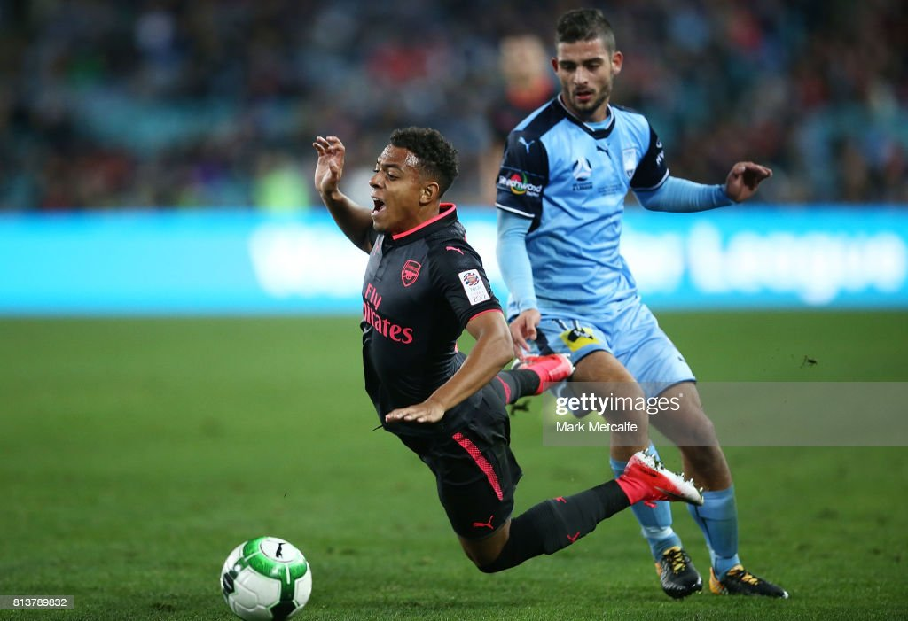 Donyell Malen of Arsenal is tackled during the match between Sydney FC and Arsenal FC at ANZ Stadium on July 13, 2017 in Sydney, Australia.