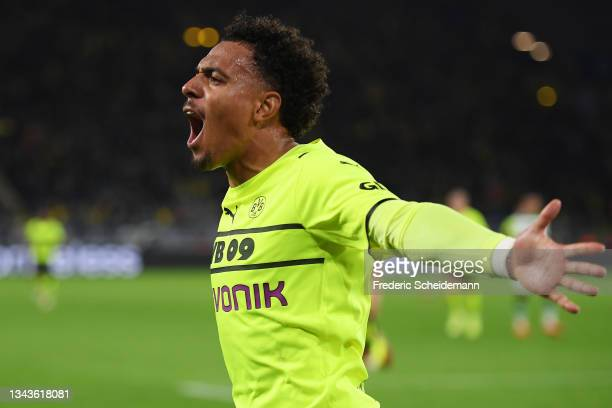 Donyell Malen of Borussia Dortmund celebrates after scoring their sides first goal during the UEFA Champions League group C match between Borussia...