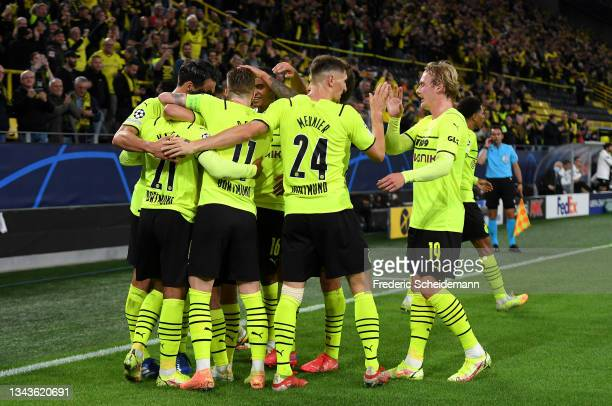 Donyell Malen of Borussia Dortmund celebrates with team mates after scoring their sides first goal during the UEFA Champions League group C match...
