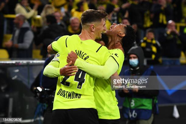 Donyell Malen of Borussia Dortmund celebrates with team mates Jude Bellingham and Thomas Meunier after scoring their sides first goal during the UEFA...