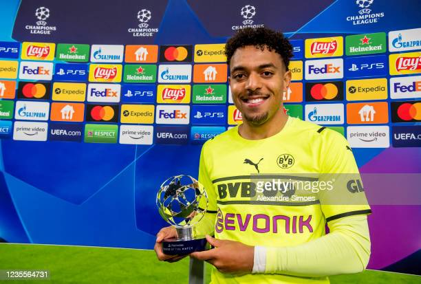 Donyell Malen of Borussia Dortmund with his Man Of The Match trophy after the final whistle during the Champions League Group C match between...