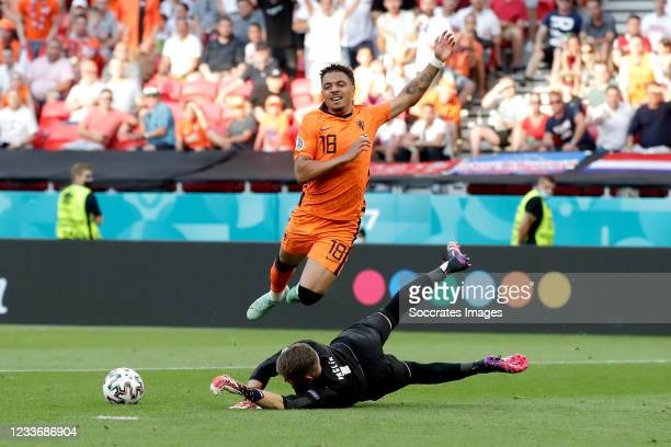Donyell Malen of Holland, Tomas Vaclik of Czech Republic during the EURO match between Holland v Czech Republic at the Puskas Arena on June 27, 2021...