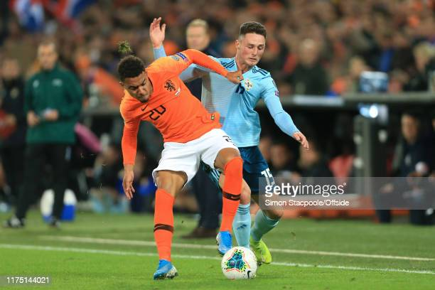 Donyell Malen of Netherlands battles with Jordan Jones of Northern Ireland during the UEFA Euro 2020 qualifier between Netherlands and Northern...