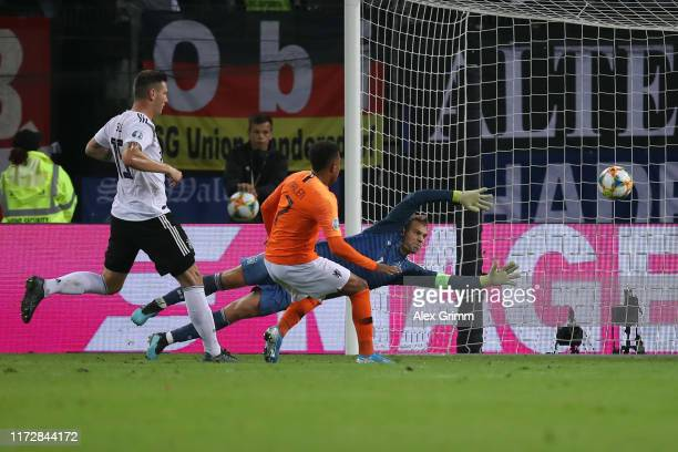 Donyell Malen of Netherlands scores his team's third goal against goalkeeper Manuel Neuer of Germany during the UEFA Euro 2020 qualifier match...