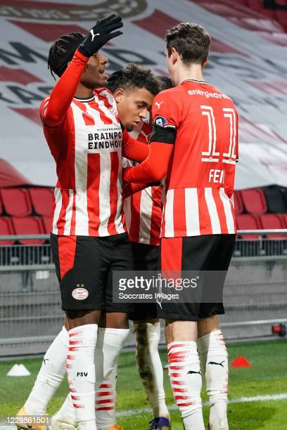 Donyell Malen of PSV celebrate his goal 1-0, penalty, Noni Madueke of PSV, Adrian Fein of PSV, during the Dutch Eredivisie match between PSV v Sparta...