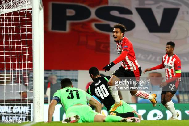 Donyell Malen of PSV celebrates scoring his teams first goal of the game during the UEFA Europa League Group E stage match between PSV Eindhoven and...