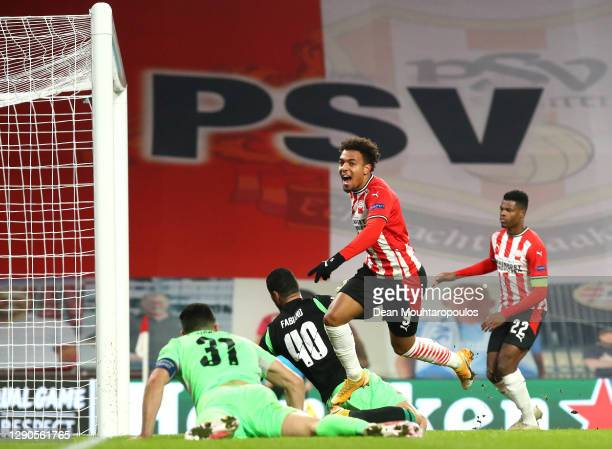 Donyell Malen of PSV Eindhoven celebrates after he scores their team's first goal during the UEFA Europa League Group E stage match between PSV...