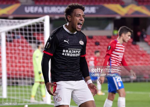 Donyell Malen of PSV Eindhoven celebrates after scoring his team's first goal during the UEFA Europa League Group E stage match between Granada CF...