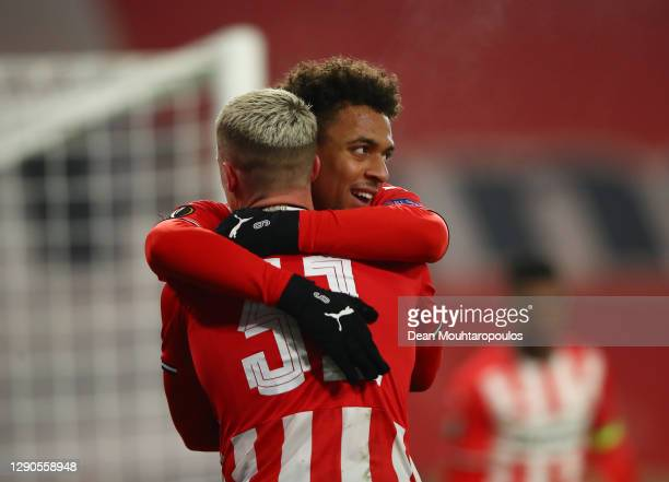Donyell Malen of PSV Eindhoven celebrates with Philipp Max of PSV Eindhoven after scoring his sides 1st goal during the UEFA Europa League Group E...