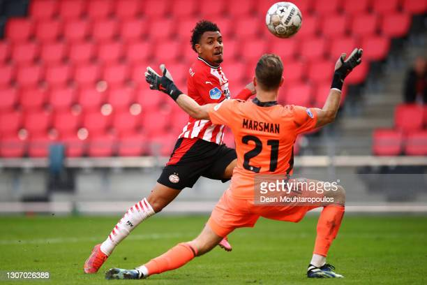 Donyell Malen of PSV scores his teams first goal past Goalkeeper, Nick Marsman of Feyenoord Rotterdam during the Dutch Eredivisie match between PSV...