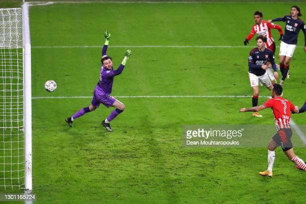 Donyell Malen of PSV scores his teams third goal past Goalkeeper, Joel Drommel of FC Twente during the Dutch Eredivisie match between PSV Eindhoven...