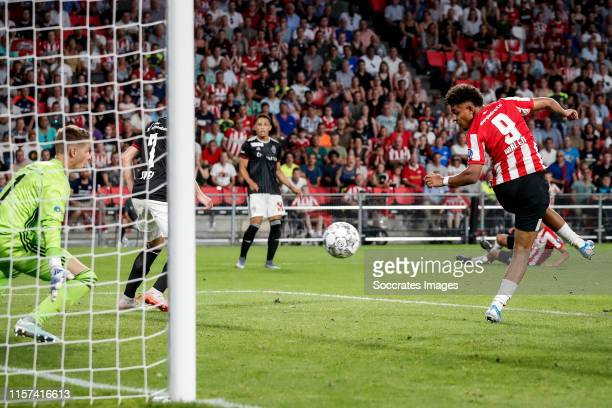 Donyell Malen of PSV scores the fifth goal to make it 3-2 during the UEFA Champions League match between PSV v Fc Basel at the Philips Stadium on...