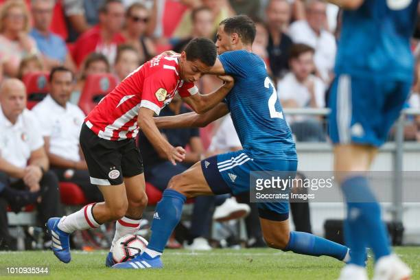 Donyell Malen of PSV Sofyan Amrabat of Feyenoord during the Dutch Johan Cruijff Schaal match between PSV v Feyenoord at the Philips Stadium on August...