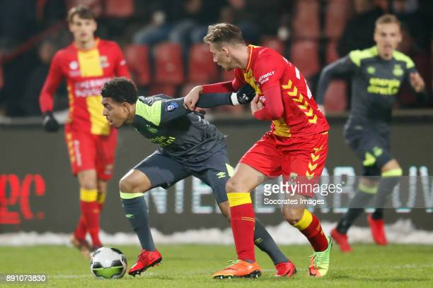 Donyell Malen of PSV U23 Dennis Hettinga of Go Ahead Eagles during the Dutch Jupiler League match between Go Ahead Eagles v PSV U23 at the De...