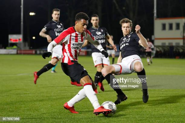 Donyell Malen of PSV U23 Jeroen Veldmate of FC Emmen during the Dutch Jupiler League match between PSV U23 v FC Emmen at the De Herdgang on March 5...