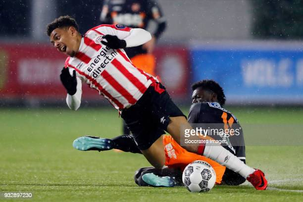 Donyell Malen of PSV U23 Rodney Antwi of FC Volendam during the Dutch Jupiler League match between PSV U23 v FC Volendam at the De Herdgang on March...
