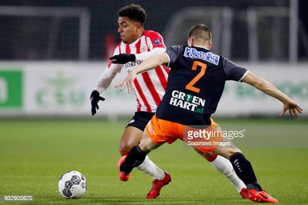 Donyell Malen of PSV U23 Ties Evers of FC Volendam during the Dutch Jupiler League match between PSV U23 v FC Volendam at the De Herdgang on March 16...