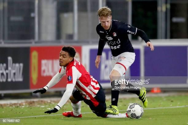 Donyell Malen of PSV U23 Youri Loen of FC Emmen during the Dutch Jupiler League match between PSV U23 v FC Emmen at the De Herdgang on March 5 2018...