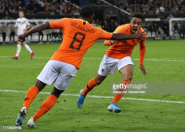 Donyell Malen of the Netherlands celebrates with teammate Georginio Wijnaldum after scoring his team's third goal during the UEFA Euro 2020 qualifier...