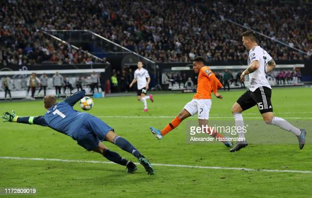 Donyell Malen of the Netherlands scores his team's third goal during the UEFA Euro 2020 qualifier match between Germany and Netherlands at...