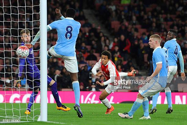 Donyell Malen scores Arsenal's 2nd goal past Daniel Grimshaw and Rodney Kongolo of Manchester City during the match between Arsenal U18 and...