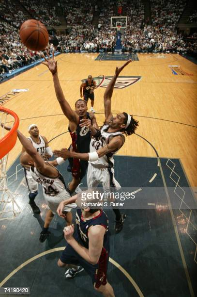 Donyell Marshall of the Cleveland Cavaliers shoots against Richard Jefferson and Mikki Moore of the New Jersey Nets in Game Six of the Eastern...