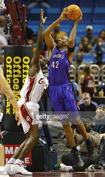 f8d848e8c36 Donyell Marshall of the Toronto Raptors goes up for a shot over Darius Miles  of the