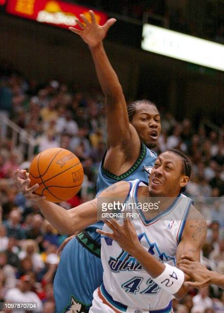 Donyell Marshall of the Utah Jazz is fouled by Avery Williams of the Minnesota Timberwolves 02 March 2002 in Salt Lake City Utah Minnesota won the...